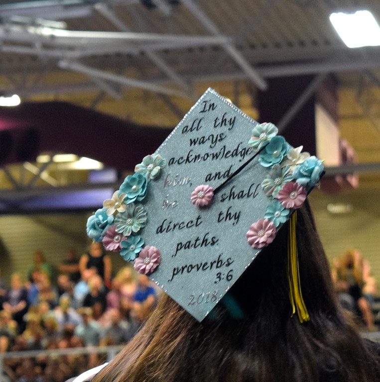 ". ""In all thy ways acknowledge him, and he shall direct they paths\"" Proverbs 3:6 reads one of graduates\' caps at Northeastern Junior College\'s commencement ceremony Friday, May 11, 2018."