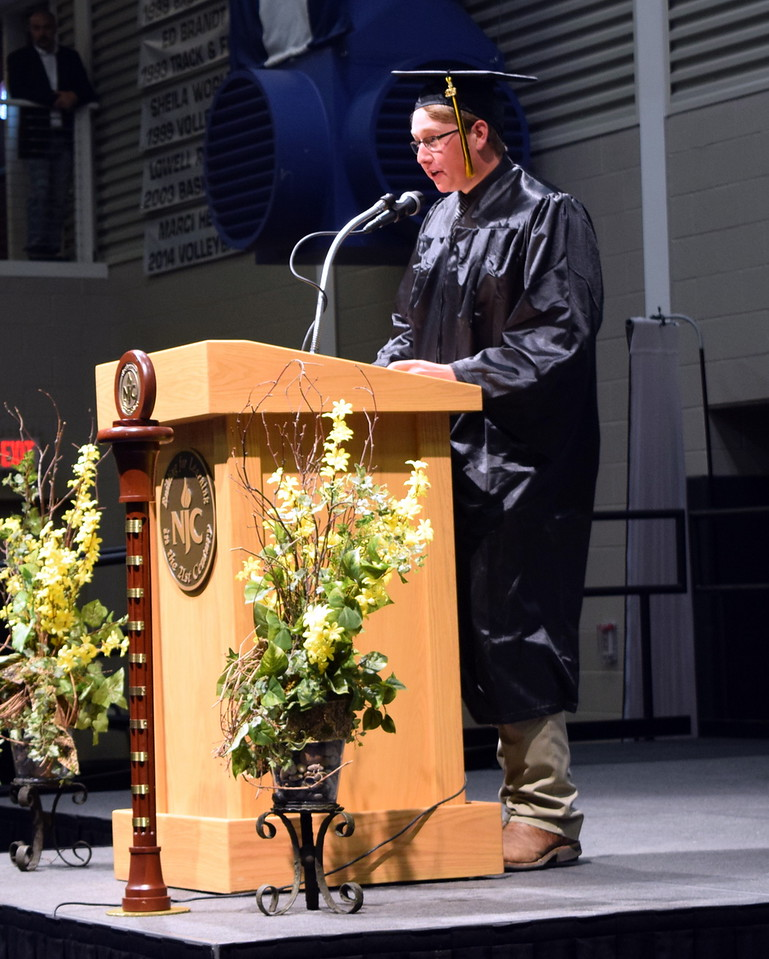 Northeastern Junior College graduate Adam Davis gives the benediction at the closing of the commencement ceremony Friday, May 11, 2018.