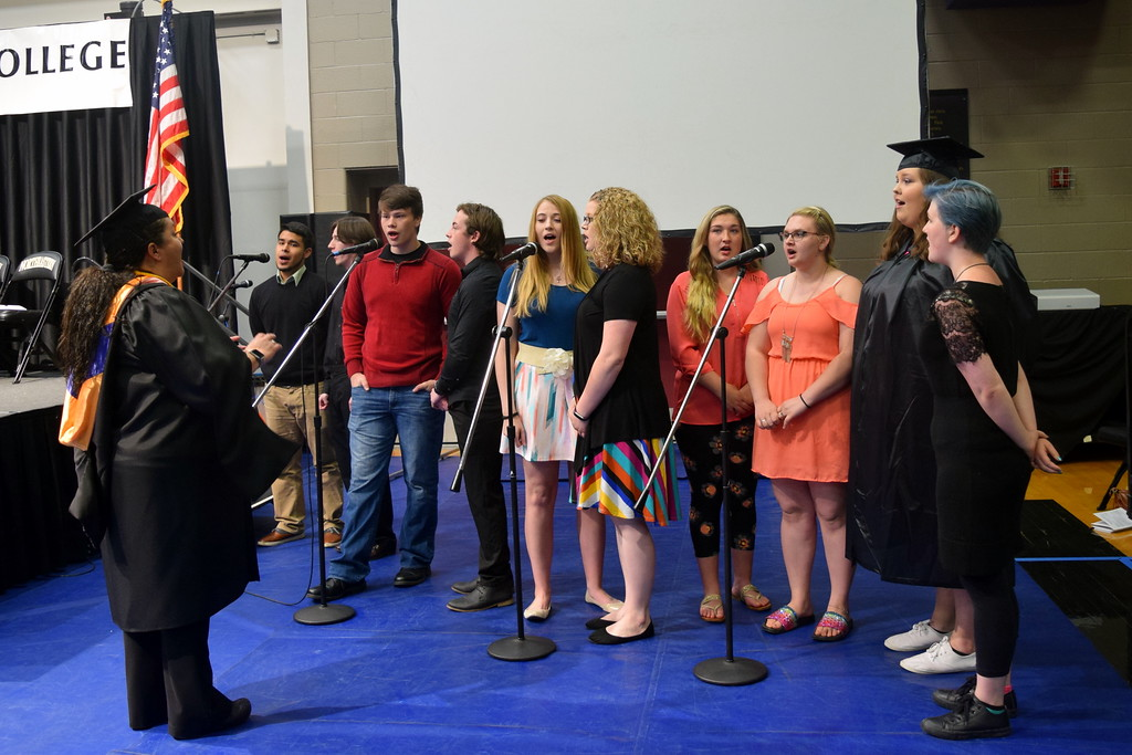 . The Northeastern Junior College Contemporary Choir performs the National Anthem, under the direction of Celeste Delgado-Pelton, during the college\'s commencement ceremony Friday, May 11, 2018.