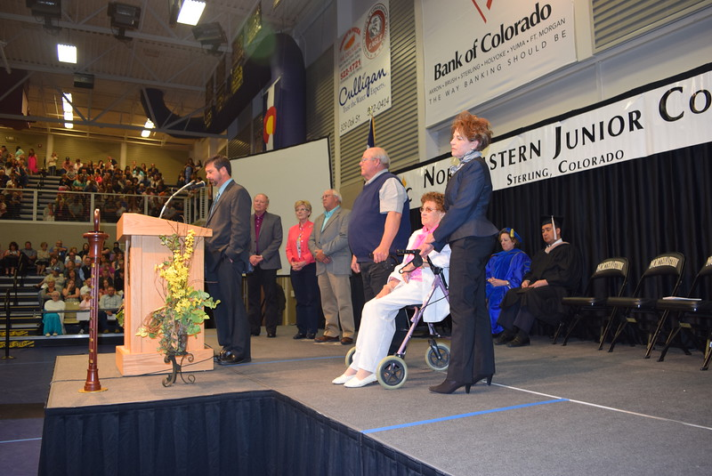 David Huss, president of the Northeastern Junior College Alumni Association, shares the background of the Pride in Association Award recipient the Philip and Josephine Foy Family at Northeastern Junior College's Commencement Ceremony Friday, May 13, 2016.