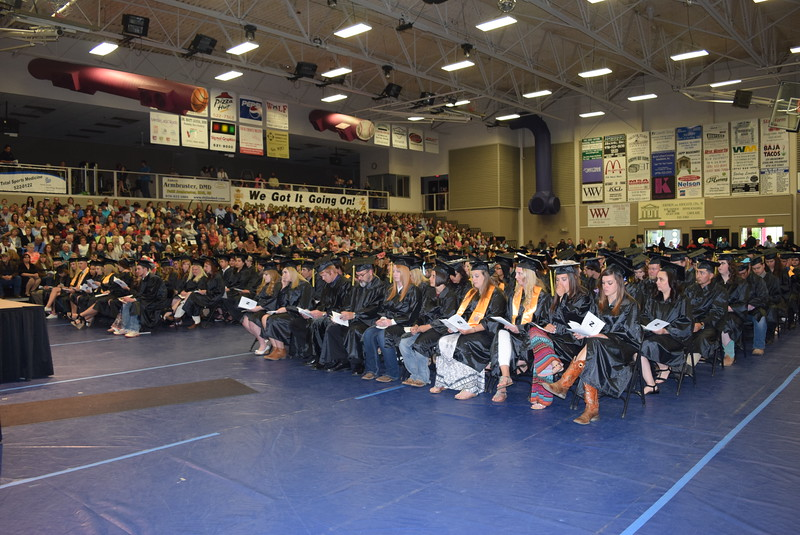 Graduates listen to one of the speakers during Northeastern Junior College's Commencement Ceremony Friday, May 13, 2016.