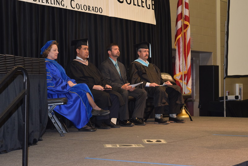 Listening to Northeastern Junior College President Jay Lee give remarks at Northeastern Junior College's Commencement Ceremony Friday, May 13, 2016, are, from left; Dr. Nancy McCallin, president of the Colorado Community College System; Richard Martinez Jr., chair of the CCCS board of directors; David Huss, president of the NJC Alumni Association board of directors; and Mike Anderson, chair of the agriculture department, who announced the degree recipients.