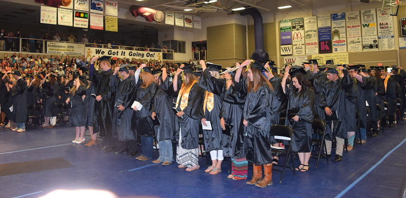 Graduates of Northeastern Junior College flip their tassles at the end of the college's commencement ceremony Friday, May 13, 2016.