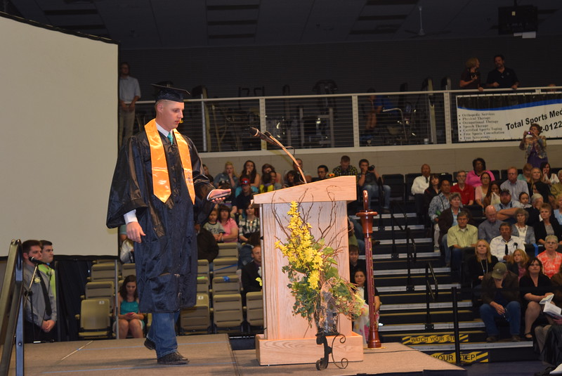 Michael Semler makes his way to the podium to give the benediction at Northeastern Junior College's Commencement Ceremony Friday, May 13, 2016.