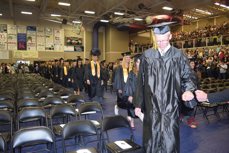 Graduates make their way into the Bank of Colorado Events Center for Northeastern Junior College's Commencement Ceremony Friday, May 13, 2016.