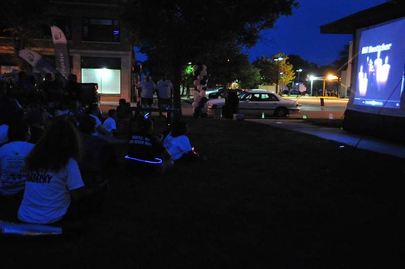 Relay For Life participants watch the Luminaria Ceremony slideshow Saturday, June 13, 2015.