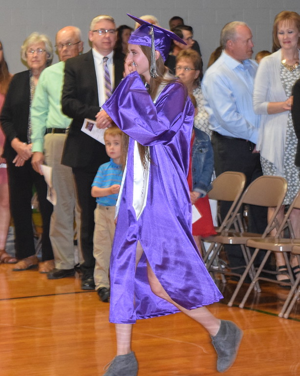 . Peetz High School graduate Abby White makes her way to the stage at the start of the school\'s commencement ceremony Sunday, May 13, 2018.
