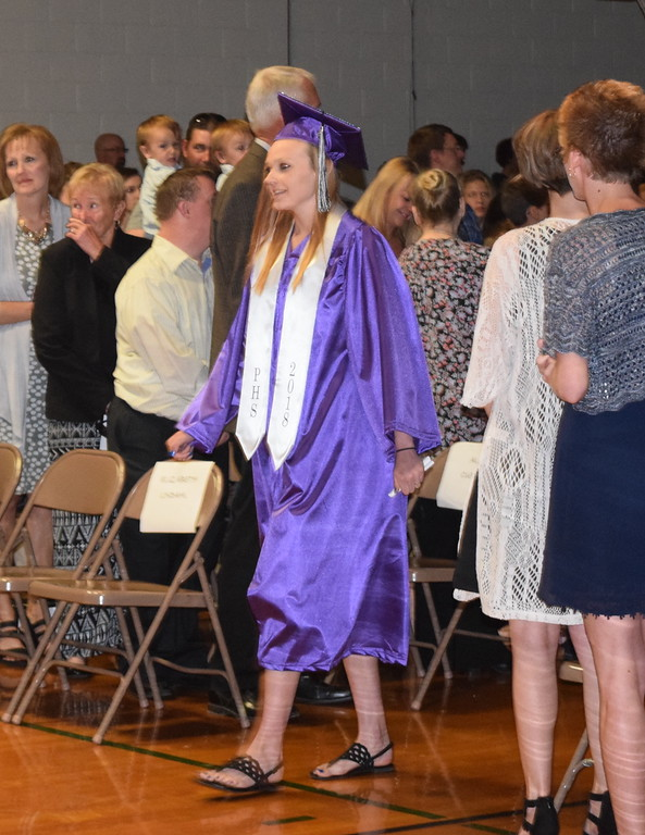. Peetz High School graduate Kora Hradecky makes her way to the stage at the start of the school\'s commencement ceremony Sunday, May 13, 2018.