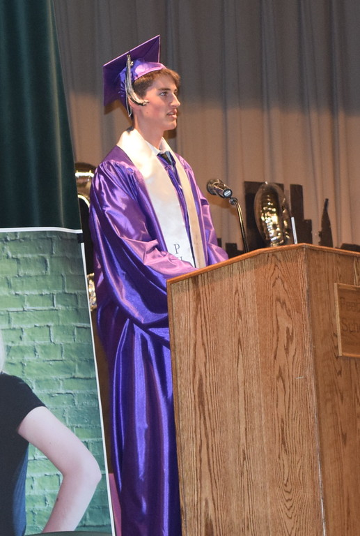 . Peetz High School graduate Gabriel Naegele gives the benediction at the close of the commencement ceremony Friday, May 13, 2018.