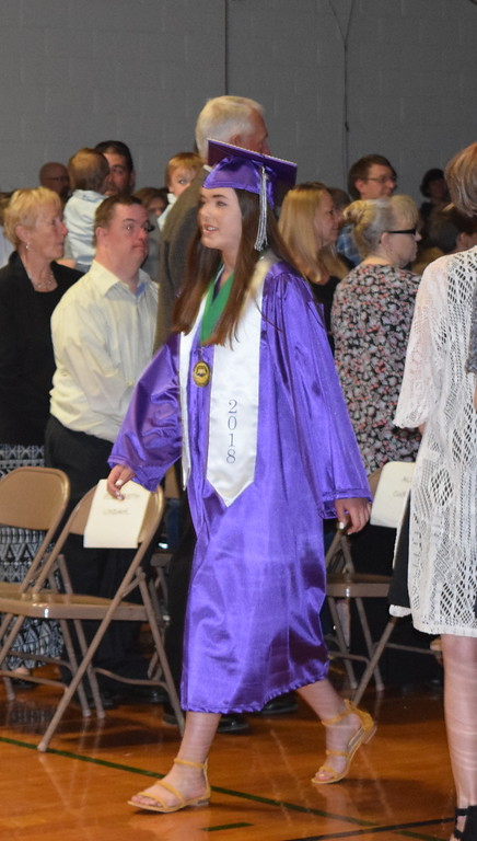 . Peetz High School graduate Elizabeth Lindahl makes her way to the stage at the start of the school\'s commencement ceremony Sunday, May 13, 2018.