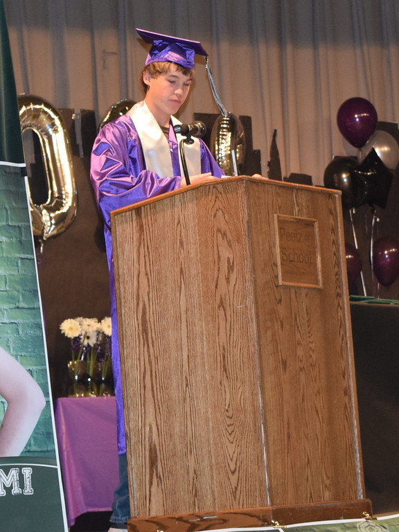 . Peetz High School graduate Tre Fehringer gives the invocation at the commencement ceremony Sunday, May 13, 2018.