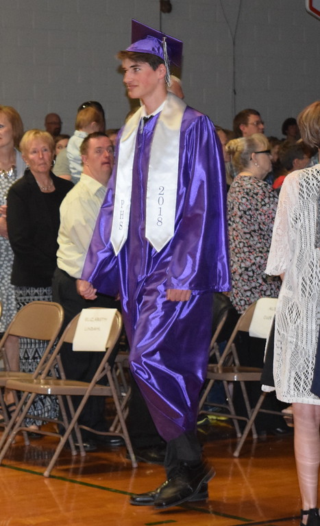 . Peetz High School graduate Gabriel Naegele makes his way to the stage at the start of the school\'s commencement ceremony Sunday, May 13, 2018.