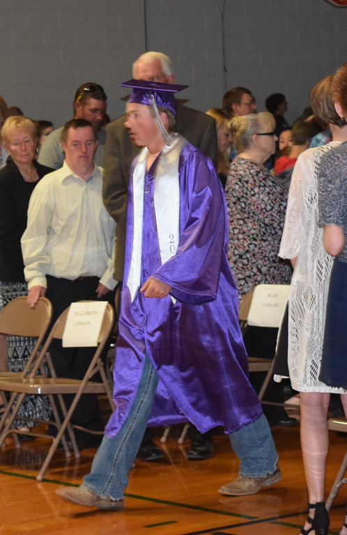 . Peetz High School graduate Hunter White makes his way to the stage at the start of the school\'s commencement ceremony Sunday, May 13, 2018.