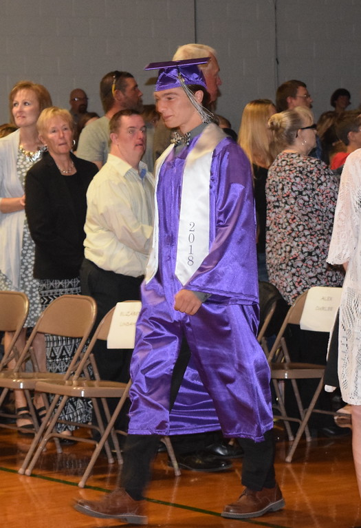. Peetz High School graduate Helmuth Wenneker makes his way to the stage at the start of the school\'s commencement ceremony Sunday, May 13, 2018.