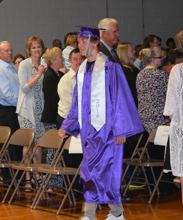 . Peetz High School graduate Jacob Curlee makes his way to the stage at the start of the school\'s commencement ceremony Sunday, May 13, 2018.
