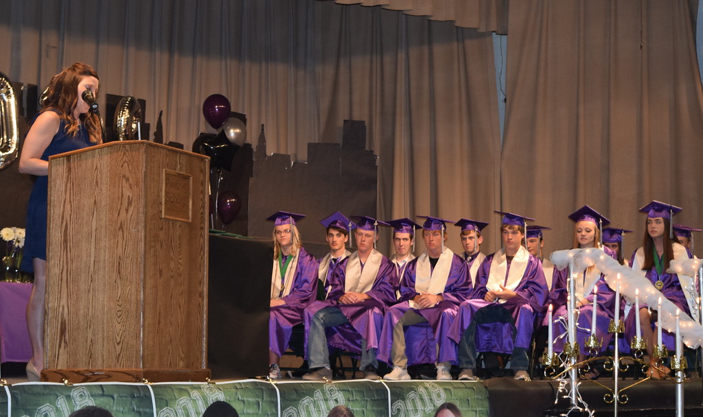 . Counselor Megan Schumacher congratulates Peetz High School graduates on the $76,000 worth of scholarships they received and shares each graduates plans during the commencement ceremony Sunday, May 13, 2018.