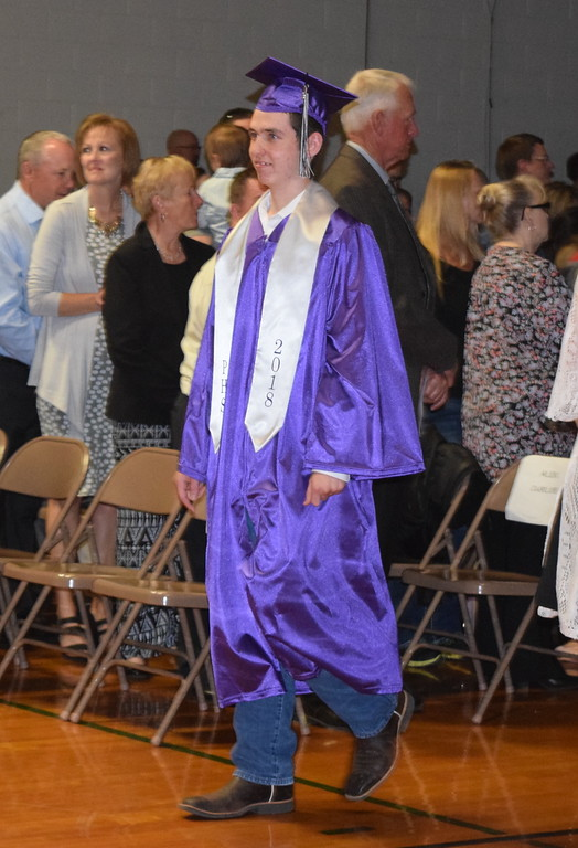 . Peetz High School graduate Charles Roderick makes his way to the stage at the start of the school\'s commencement ceremony Sunday, May 13, 2018.