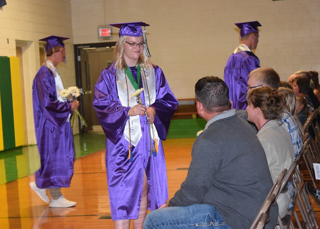 . Peetz High School graduates present flowers to their family and friends during the commencement ceremony Sunday, May 13, 2018.