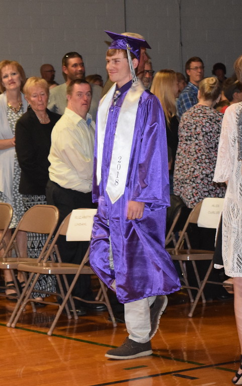. Peetz High School graduate Logan Sircy makes his way to the stage at the start of the school\'s commencement ceremony Sunday, May 13, 2018.