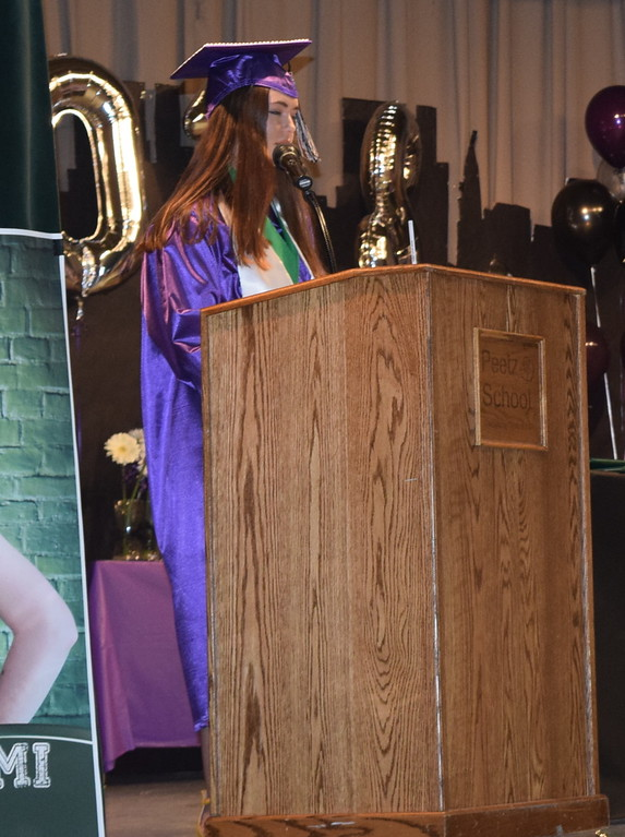 . Salutatorian Elizabeth Lindahl gives remarks at Peetz High School\'s commencement ceremony Sunday, May 13, 2018.