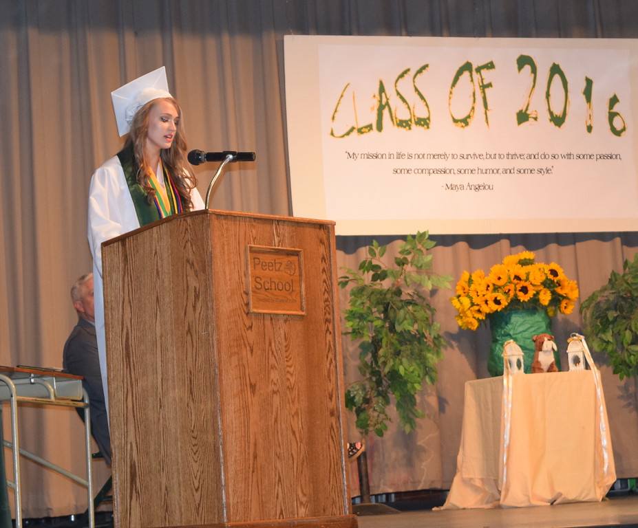 Valedictorian Mikenna Curlee encourages her classmates to continue to overcome challenges during Peetz High School's commencement ceremony Sunday, May 15, 2016.