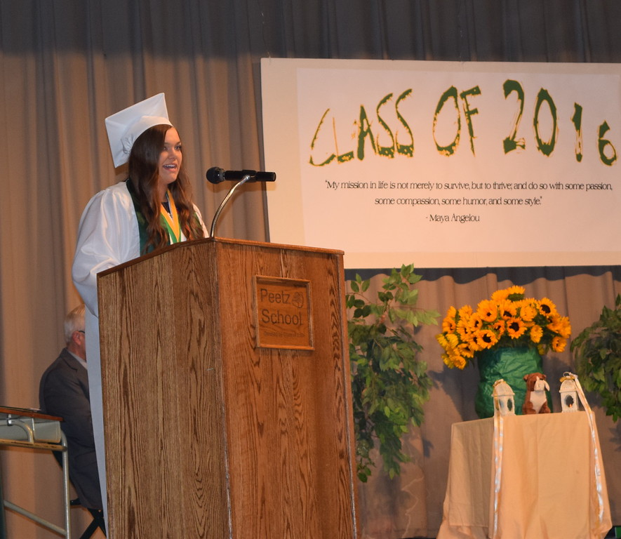 Salutatorian Jodie Schumacher shares memories about her classmates during Peetz High School's commencement ceremony Sunday, May 15, 2016.