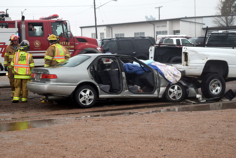 The wreckage of the two vehicles and a deceased body are all that remain at the scene of a mock car accident during an Every 15 Minutes program at Peetz School Tuesday, March 28, 2017.