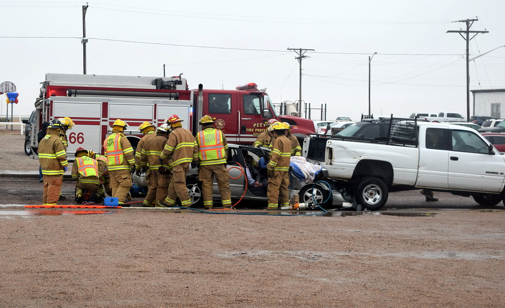 . Firefighters from Peetz Fire Department work to extricate victims of a mock car crash that was the result of texting while driving during an Every 15 Minutes program put on at Peetz School Tuesday, March 28, 2017.