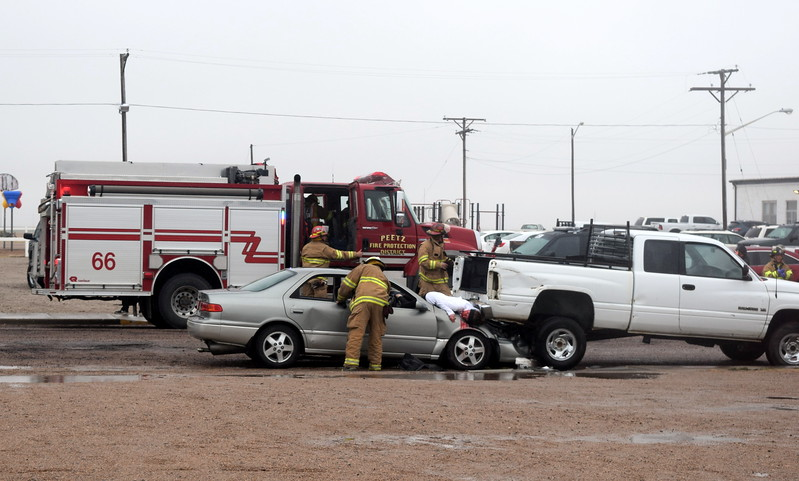 Firefighters from Peetz Fire Department arrive on scene and start checking victims of a mock car accident during an Every 15 Minutes program at Peetz School Tuesday, March 28, 2017.