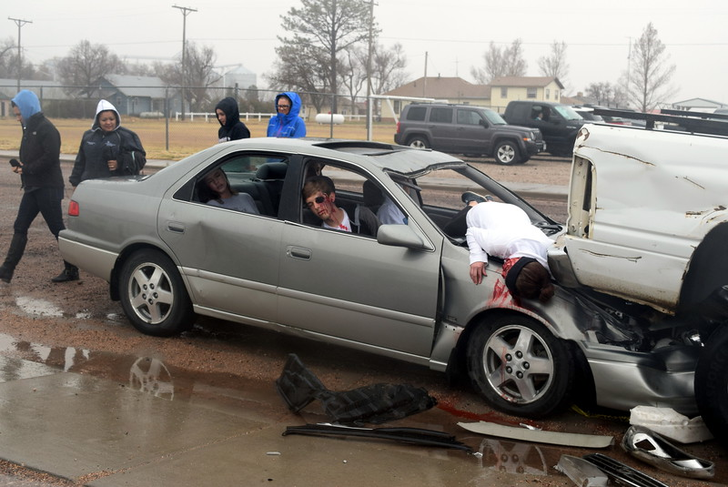 Peetz School students look over scene of a mock accident as they make their way to the bus barn to watch the response of firefighters and first responders as they arrive on the scene of the accident, during an Every 15 Minutes program Tuesday, March 28, 2017. The mock car accident showed students the deadly consequences of texting while driving or driving distracted.