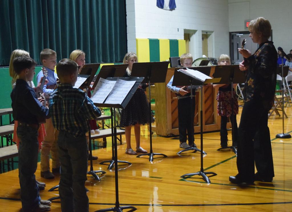 ". Third grade ukulele players perform \""God Rest Ye Merry, Gentlemen,\"" under the direction of Jamie Wheelock, during Peetz School\'s K-12 Winter Concert Thursday, Dec. 14, 2017."