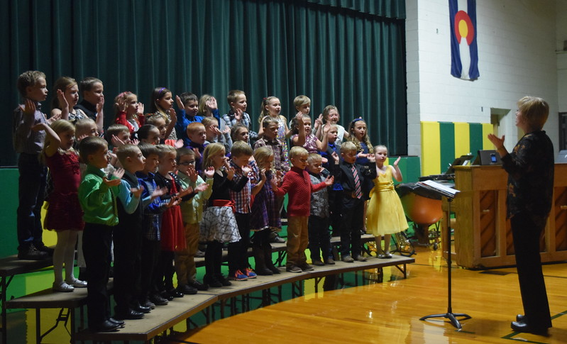 "Kindergarten through second grade students perform ""Penguin Polka,"" under the direction of Jamie Wheelock, during Peetz School's K-12 Winter Concert Thursday, Dec. 14, 2017."