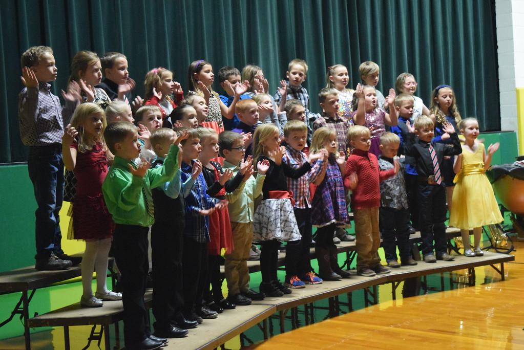 ". Kindergarten through second grade students perform \""Penguin Polka,\"" under the direction of Jamie Wheelock, during Peetz School\'s K-12 Winter Concert Thursday, Dec. 14, 2017."