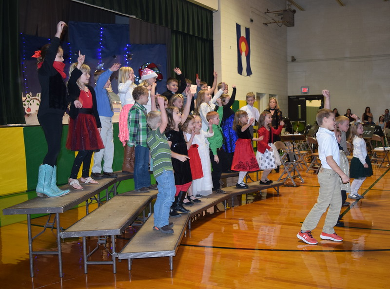 "Peetz School's kindergarten through second graders dance and sing to ""Groovin' Elf,' under the direction of Jamie Wheelock, during the school's Winter Concert, Tuesday, Dec. 6, 2016."