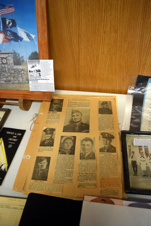 """. The Peetz American Legion and Auxiliary display at the Peetz Sake Days \""""Still on the Hill\"""" Centennial Celebration Saturday, Sept. 30, 2017, featured photographs of military servicemen from Peetz."""