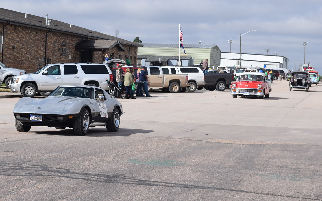 """. Classic cars carrying longtime Peetz residents make their way down the parade route during the Peetz Sake Days \""""Still on the Hill\"""" Centennial Parade Saturday, Sept. 30, 2017."""