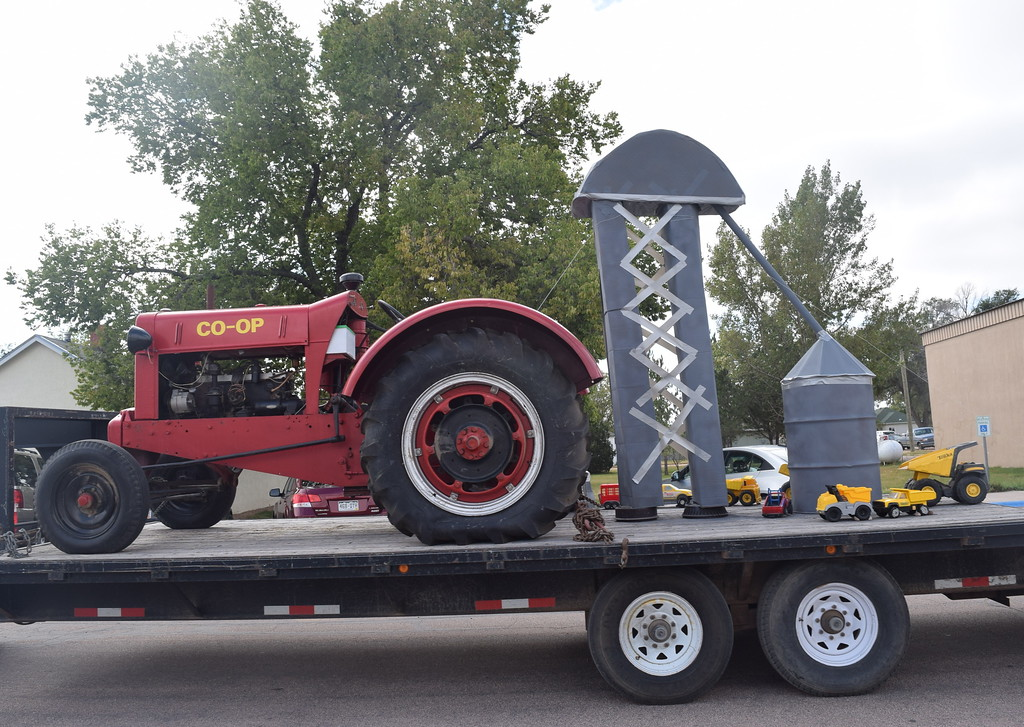 """. The Peetz Farmer\'s Cooperative Co. float makes its way down the parade route  during the Peetz Sake Days \""""Still on the Hill\"""" Centennial Parade Saturday, Sept. 30, 2017."""