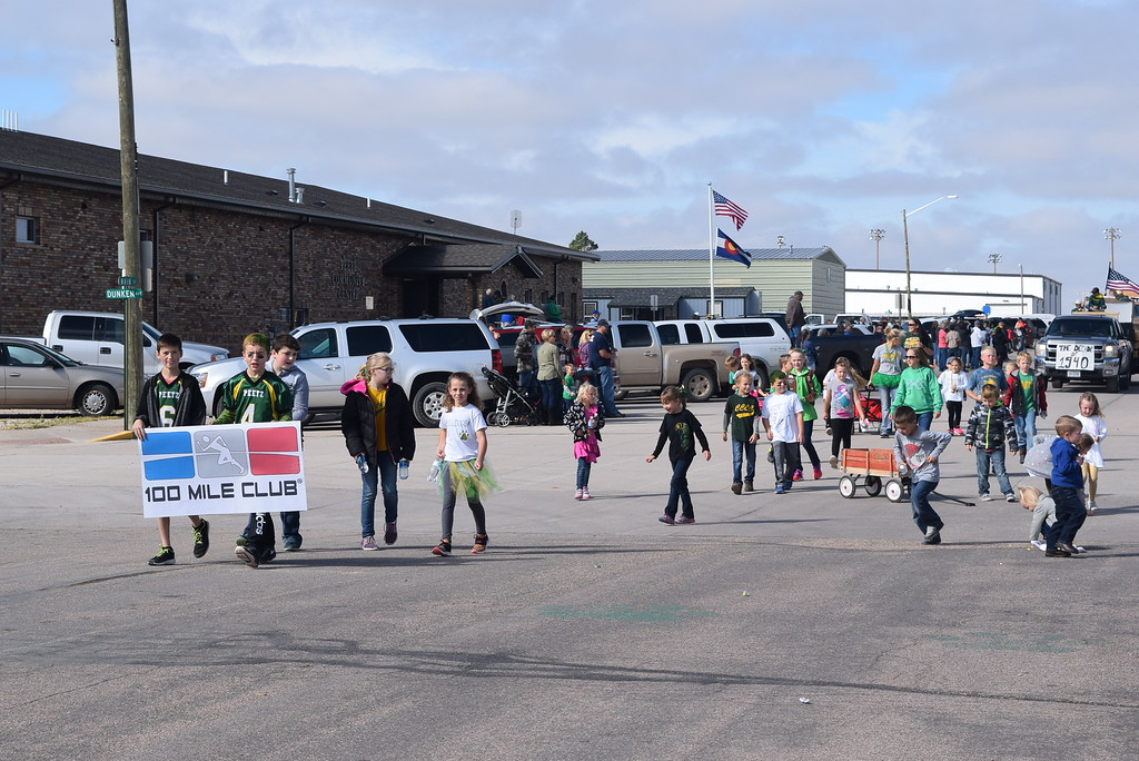 """. The 100 Mile Club makes its way down the parade route during the Peetz Sake Days \""""Still on the Hill\"""" Centennial Parade Saturday, Sept. 30, 2017."""