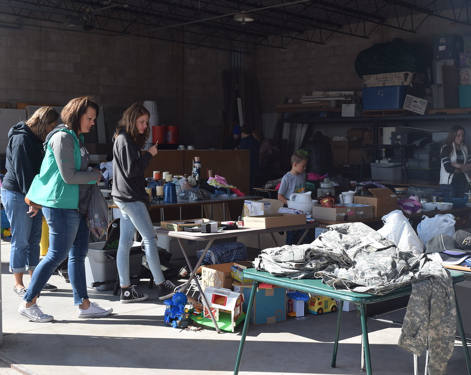 """. Guests look over items for sale at the DC Club garage sale during the Peetz Sake Days \""""Still on the Hill\"""" Centennial Celebration Saturday, Sept. 30, 2017."""