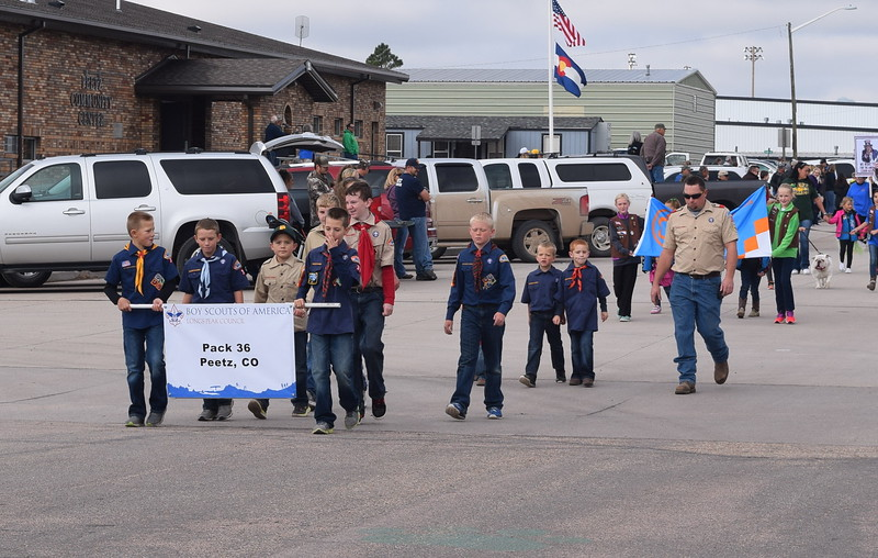 "Peetz Boy Scout Pack 36 makes its way down the parade route during the Peetz Sake Days ""Still on the Hill"" Centennial Parade Saturday, Sept. 30, 2017"