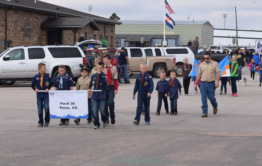 """. Peetz Boy Scout Pack 36 makes its way down the parade route during the Peetz Sake Days \""""Still on the Hill\"""" Centennial Parade Saturday, Sept. 30, 2017"""