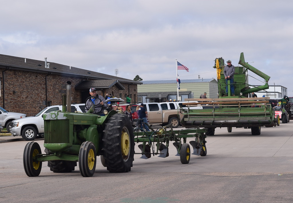 """. Farm equipment makes its way down the parade route during the Peetz Sake Days \""""Still on the Hill\"""" Centennial Parade Saturday, Sept. 30, 2017."""