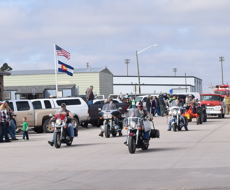 """Motorcycles make their way down the parade route during the Peetz Sake Days """"Still on the Hill"""" Centennial Parade Saturday, Sept. 30, 2017."""