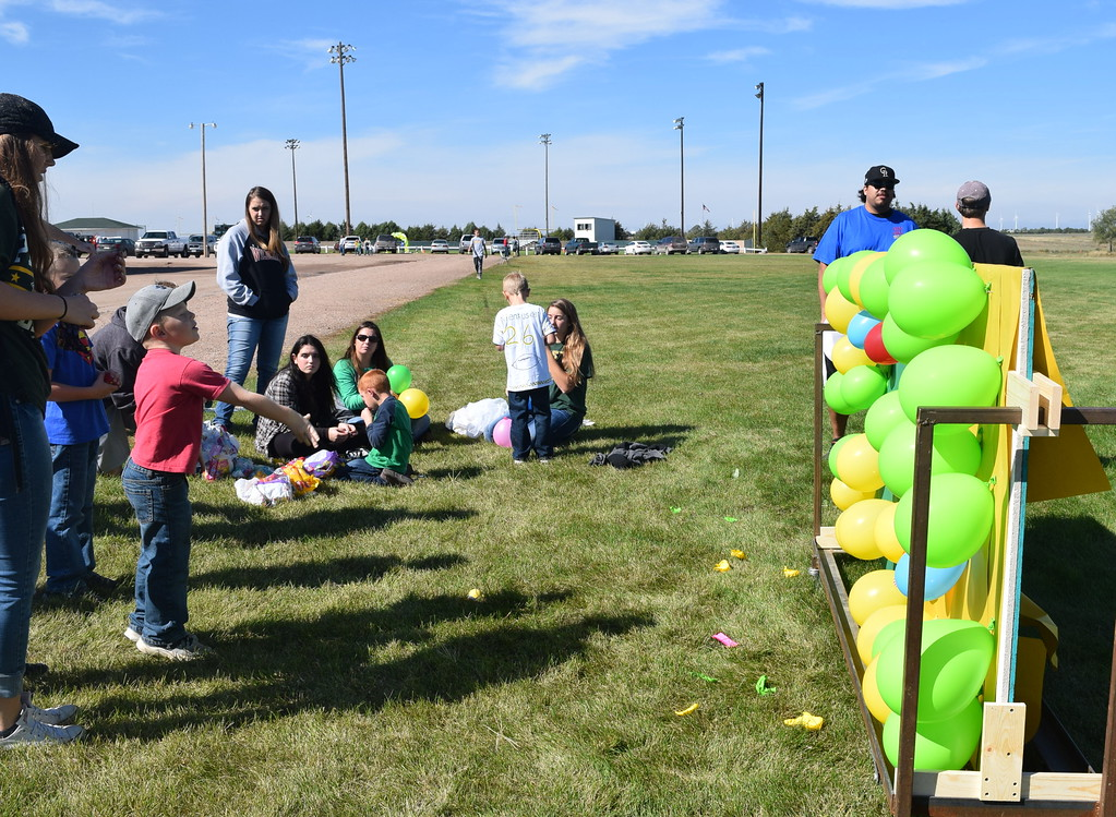 """. A youngster tries to pop a balloon with a dart at Peetz Sake Days \""""Still on the Hill\"""" Centennial Celebration Saturday, Sept. 30, 2017."""