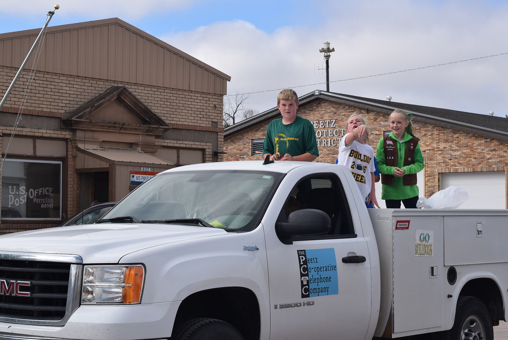""". Children toss candy from the Peetz Co-operative Telephone Company float during the Peetz Sake Days \""""Still on the Hill\"""" Centennial Parade Saturday, Sept. 30, 2017."""