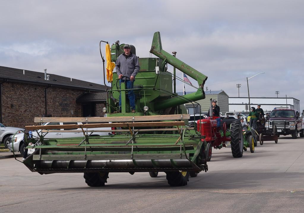 ". Adam Davis leads several pieces of farm equipment during the Peetz Sake Days \""Still on the Hill\"" Centennial Parade Saturday, Sept. 30, 2017."