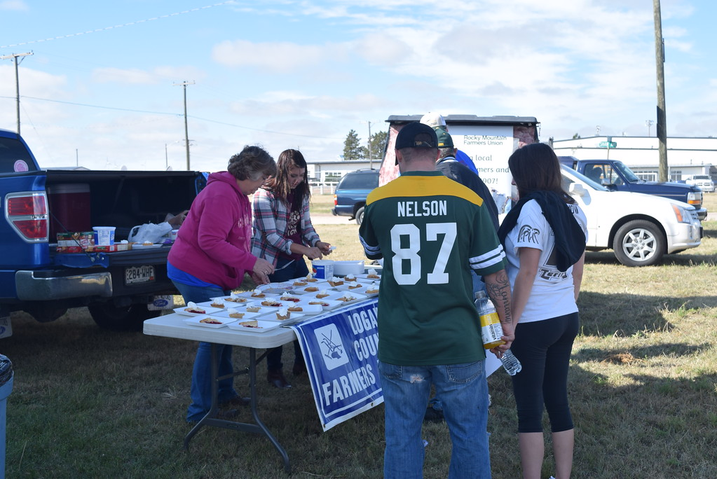 """. Visitors stop by the Logan County Rocky Mountain Farmer\'s Union booth for a piece of pie during the Peetz Sake Days \""""Still on the Hill\"""" Centennial Celebration Saturday, Sept. 30, 2017."""