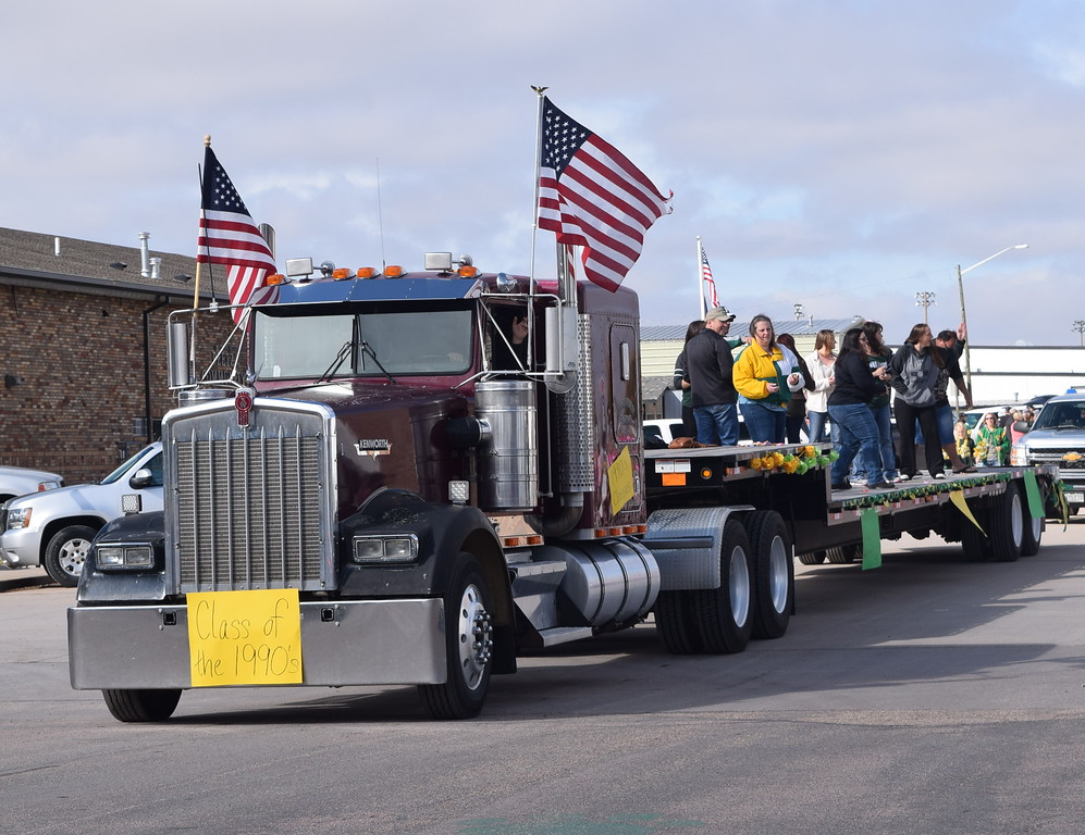 """. A float representing the Peetz High School Classes of the 1990\'s makes its way down the parade route during the Peetz Sake Days \""""Still on the Hill\"""" Centennial Parade Saturday, Sept. 30, 2017."""