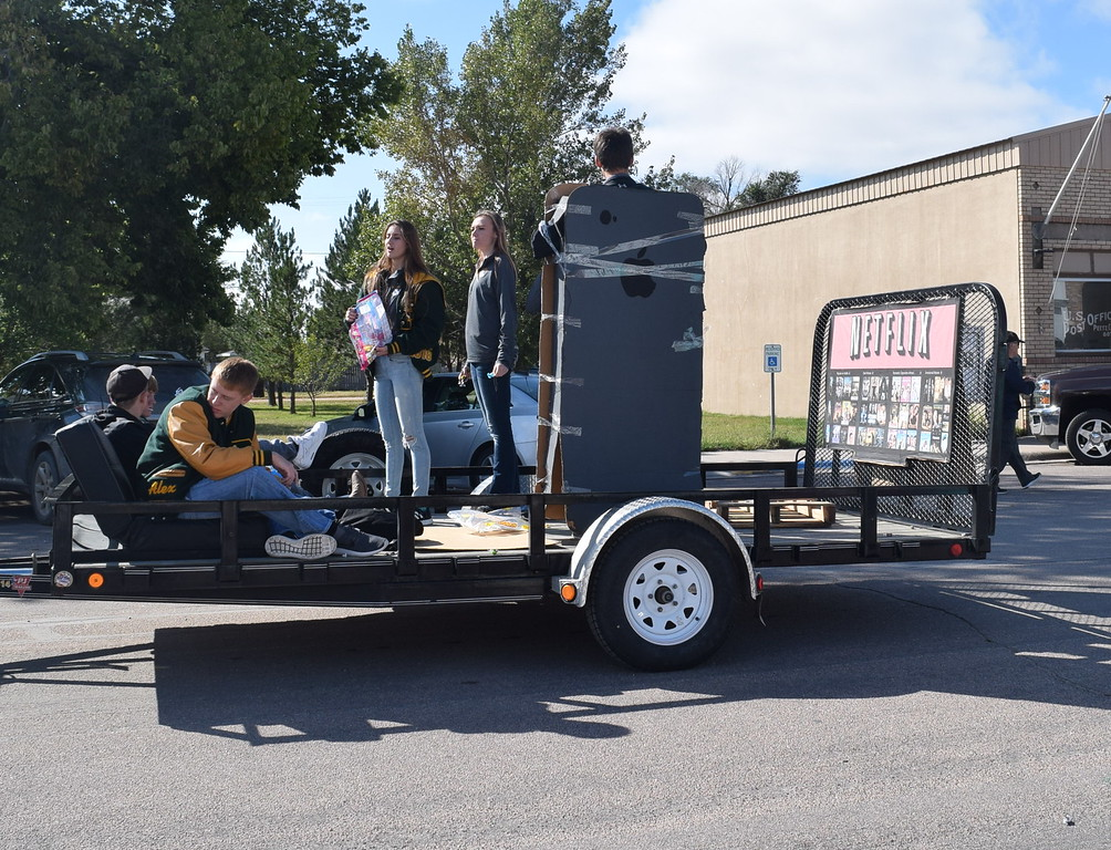 """. The 2010\'s graduates\' float showed some of the popular items from this era, including an iPhone and Netflix, during the Peetz Sake Days \""""Still on the Hill\"""" Centennial Parade Saturday, Sept. 30, 2017."""