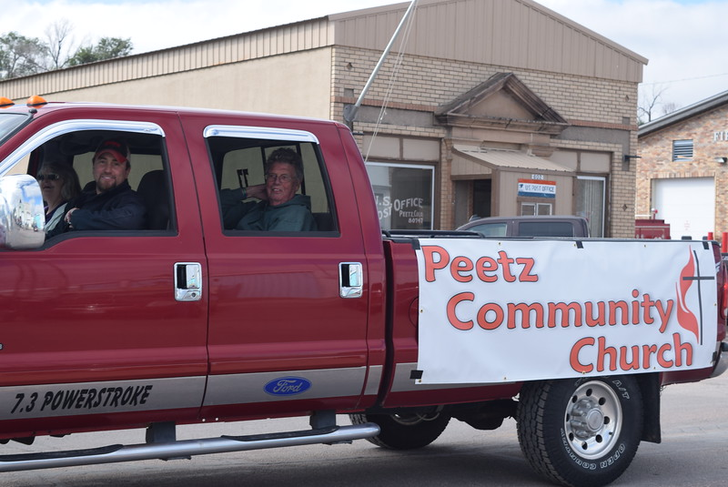 "A float from Peetz Community Church makes its way down the parade route during the Peetz Sake Days ""Still on the Hill"" Centennial Parade Saturday, Sept. 30, 2017."